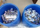 Peste 6.600 pachete cu țigări, ascunse în butoaie din plastic într-un microbuz